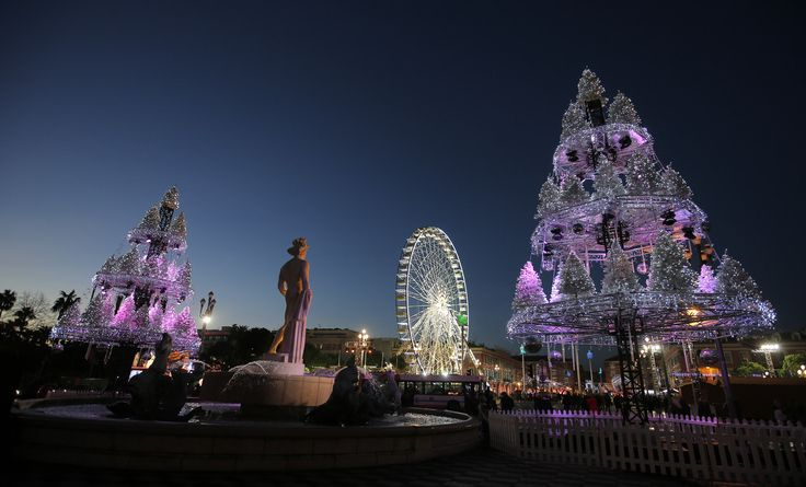 Very unique and beautiful pink lights on Christmas trees in Nice, France.*****Follow our unique garden themed boards at www.pinterest.com/earthwormtec *****Follow us on www.facebook.com/earthwormtec for great organic gardening tips