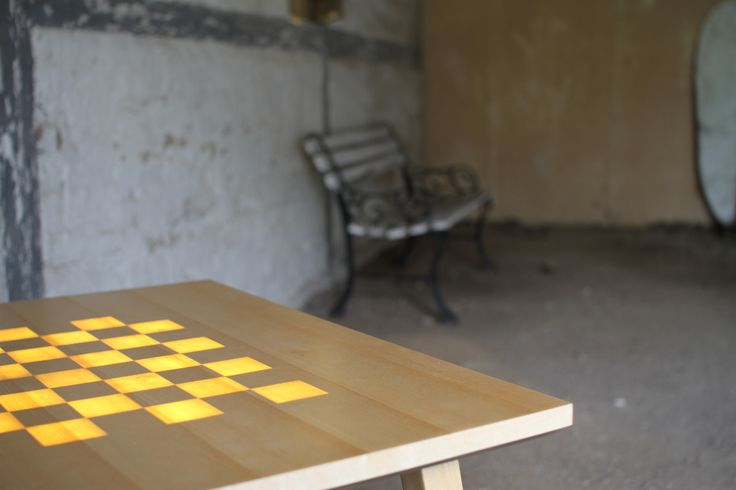 The Scandinavian Chess Table with a old swedish bench in the background.