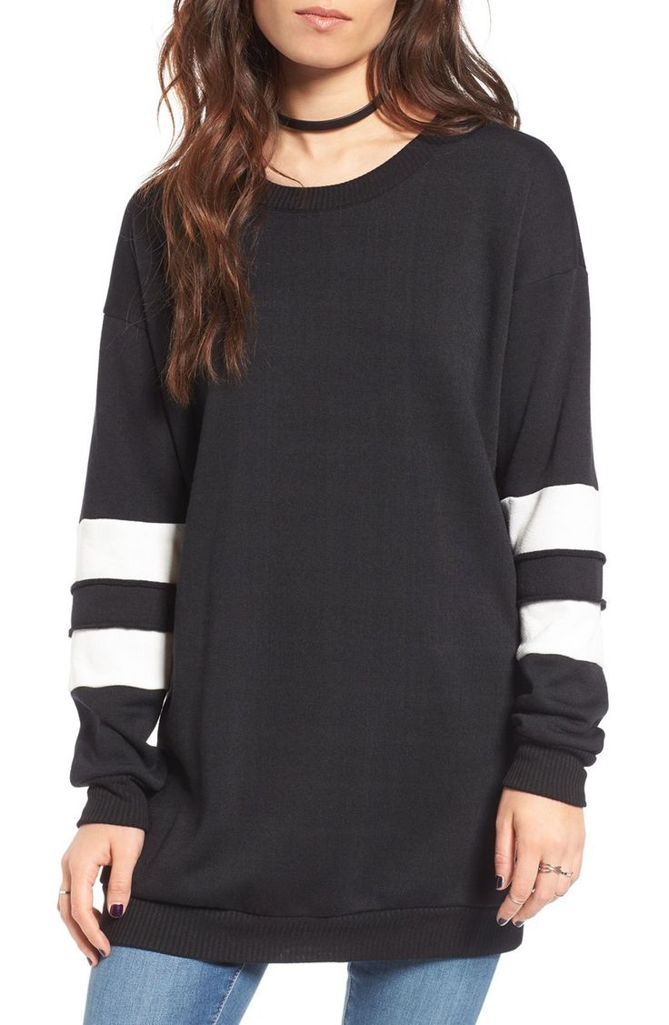 Varsity stripes pattern the dropped sleeves of this cozy sweatshirt with a tunic-inspired silhouette.