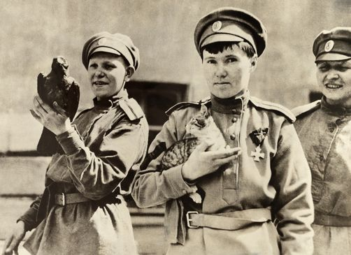 Members of the Russian World War I women's Battalion of Death. With a raptor and a young cat.