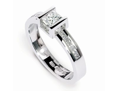 Diamond Box Highlight ring 18ct white gold Box Highlight ring by Andrew Geoghegan. A centre princess cut diamond with a channel set princess cut diamond band. Finger size L. Please contact us for other sizes. http://www.julify.com/