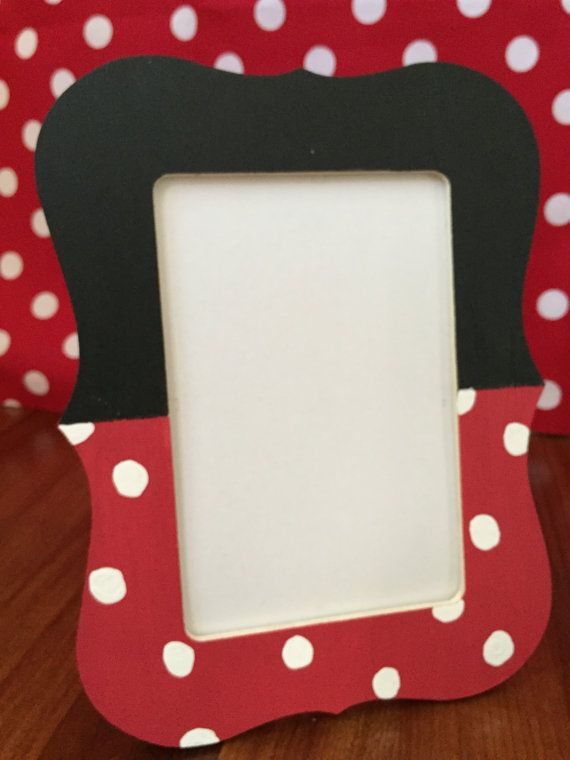 This Mickey Mouse or Minnie Mouse Picture Frame is the perfect piece to show off the birthday boy or girl on their special day. Use for party decor or in a nursery/kids room. Each wood 4x6 frame is hand painted. This frame does not contain a glass or plastic insert. Mickey inspired frames are black and red with two white buttons attached. The Minnie inspired frames are black and red with hand painted white polka dots. Minnie frame would also be great to be used for a ladybug party!  List...