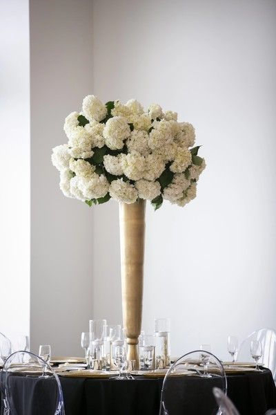 Tall centerpiece idea - white hydrangeas in tall gold vases {Pond Photography}