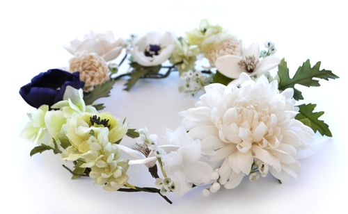 a flower crown made with hand made fabric flowers.