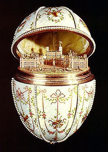 """The Gatchina Palace"" egg was made for Nicholas II of Russia for his mother, the Dowager Empress Maria Feodorovna, on Easter 1901. Crafted: gold, enamel, silver-gilt, portrait diamonds, rock crystal, and seed pearls. Surprise: minature gold replica of the palace at Gatchina with statue of Paul I. Location: Walters Art Museum, Baltimore, Maryland, USA."