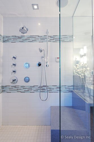 Shower tile - white subway with glass tile accent. This but only one stripe towards top to draw up the eye and make it seem taller