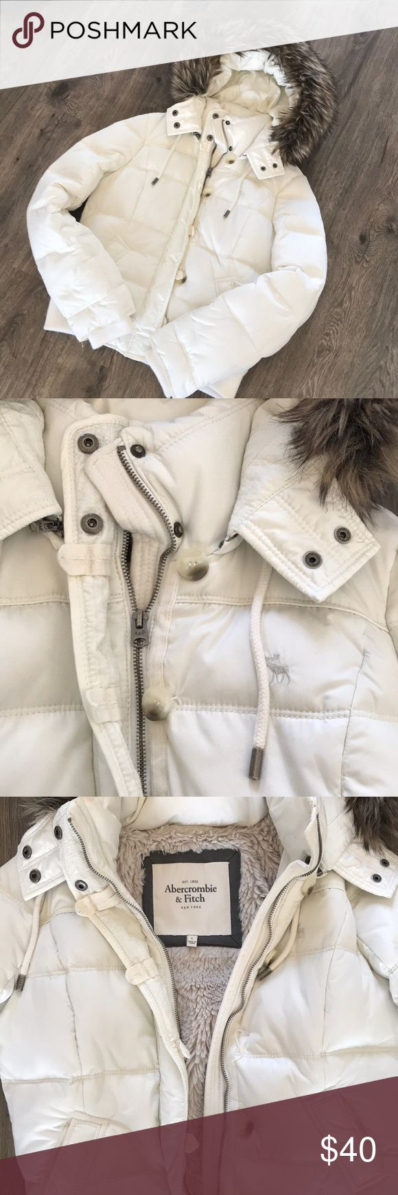 Abercrombie and Fitch snow jacket Warm puffy white jacket with removable faux fur lined hood. Inside of jacket lined with taupe colored faux fur. Abercrombie & Fitch Jackets & Coats Puffers