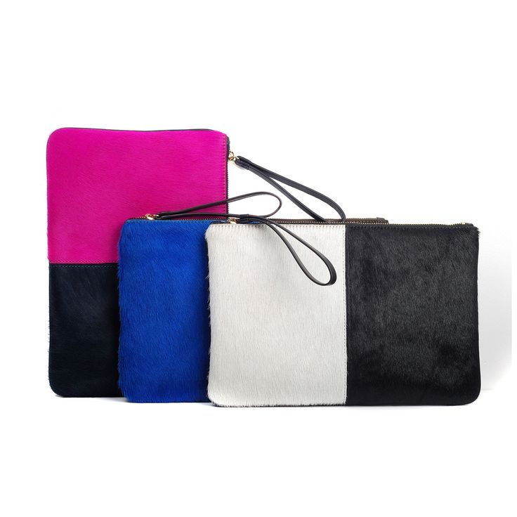 Which one is your favorite color? Ours is the Travel Clutch Amira (Fuchsia and Navy)  www.jauntaccessories.com