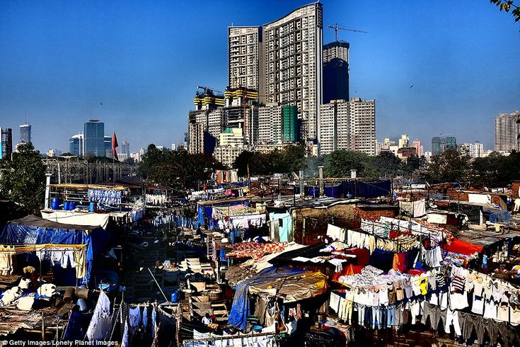Dhobi Ghat, pictured, is a famous open air laundromat in Mumbai where clothes from the hotels, embassies and beauty parlours nearby are sent to be washed