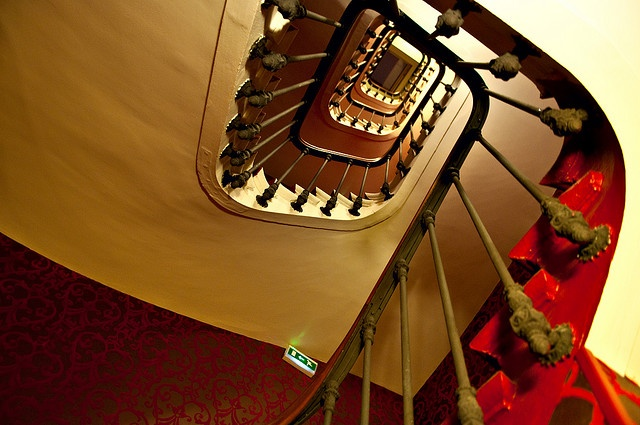 Stairway Hotel Malte Opera, Paris    From the bottom floor up to the top 4th floor the Stairway rungs along the red tapestry.