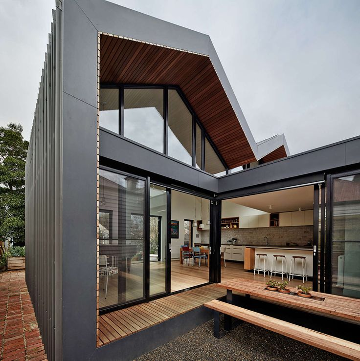 A Small Home With A Double Hip Roof With Courtyard In