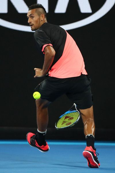 Nick Kyrgios Photos - Nick Kyrgios of Australia plays a shot between his legs in his second round match against Viktor Troicki of Serbia on day three of the 2018 Australian Open at Melbourne Park on January 17, 2018 in Melbourne, Australia. - 2018 Australian Open - Day 3