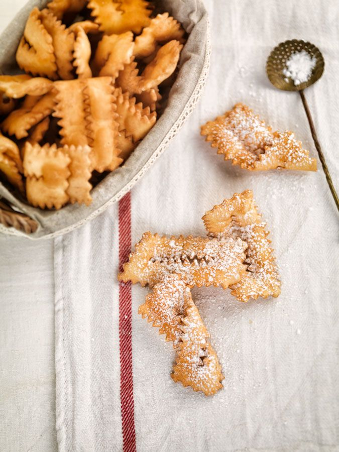 Italian Carnival treats - Chiacchiere  Regional variations in the recipe include sprinkling with orange zest or using anisette wine as the alcoholic base.