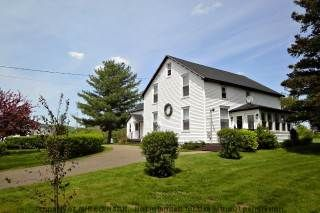 This is and early Bridgetown home with much updating throughout in recent years making it an efficient and modern home with a cozy woodstove in kitchen area and a pellet stove in the living room. Sou