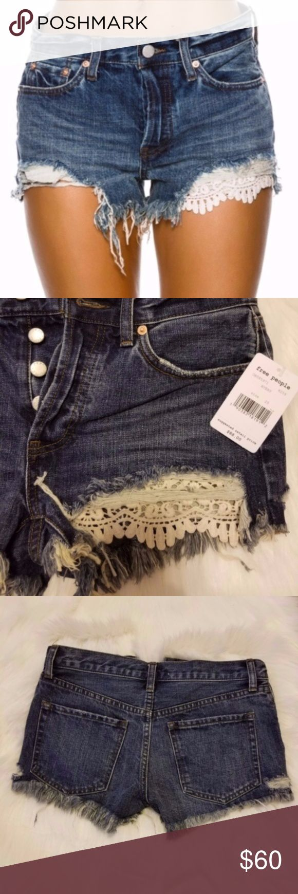 """FREE PEOPLE Daisy Chain Lace Frayed Shorts SIZE 25 Free People Daisy Chain Lace Shorts. Women's denim shorts. Non-stretch rigid denim. Five-pocket style. Button fly closure. Distressed detailing. Raw hem featuring peek-a-boo crochet trim. 2.5"""" inseam length. 100% Cotton.  New from smoke and pet free home. Sorry, no modeling.  Don't look at prices, make me an offer instead. Bundle encouraged. Due to the many variations in monitors and browsers, color may appear different. Free People Shorts…"""
