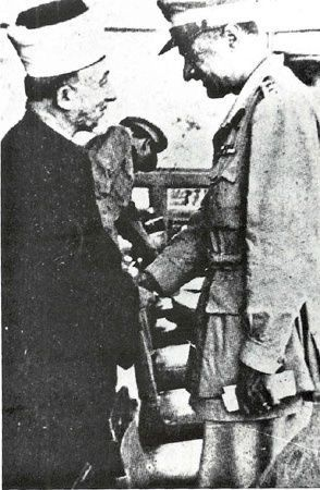 Amin Al Husseini is seen shaking hands with the President of Egypt