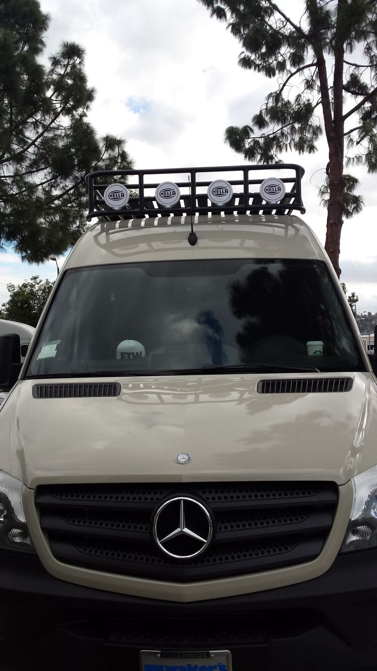 Mercedes Sprinter 4x4 with off-road aluminum voyager roof rack with tight slat flooring and Hella light mounts.