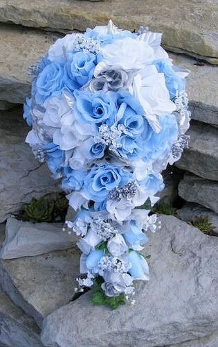 blue and silver wedding centerpieces | ... smaller Light Blue accent rose. The stem is wrapped in silver ribbon