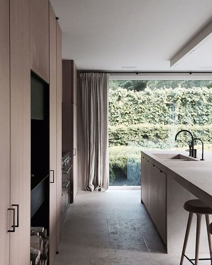 Natural Stone And Oak Veneer Kitchen By Marc Merckx O Marcmerckx Kitchendesign