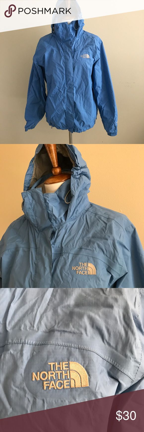 "The North Face Blue Rain Coat L The North Face Blue HyVent Rain Jacket Size Large Measures approx 23"" across the bust and 27"" in length Pre-owned with tons of life left. Some peeling inside (see photo), some piling around the neck, some fuzzies on the velcro. Outside is in nice condition The North Face Jackets & Coats"