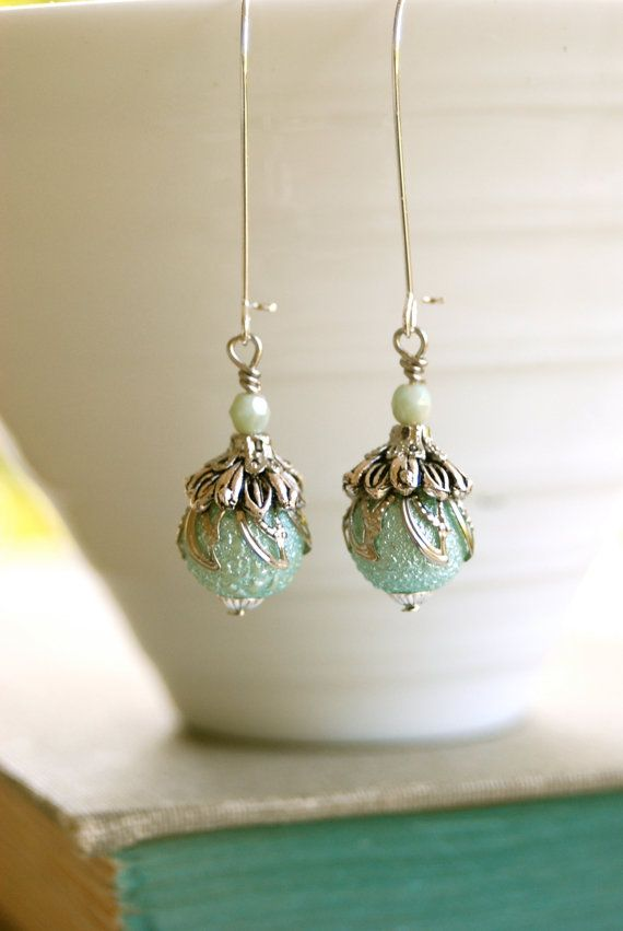Mermaid tears. aqua light blue green silver tone beaded earrings. Tiedupmemories. $16.00, via Etsy.