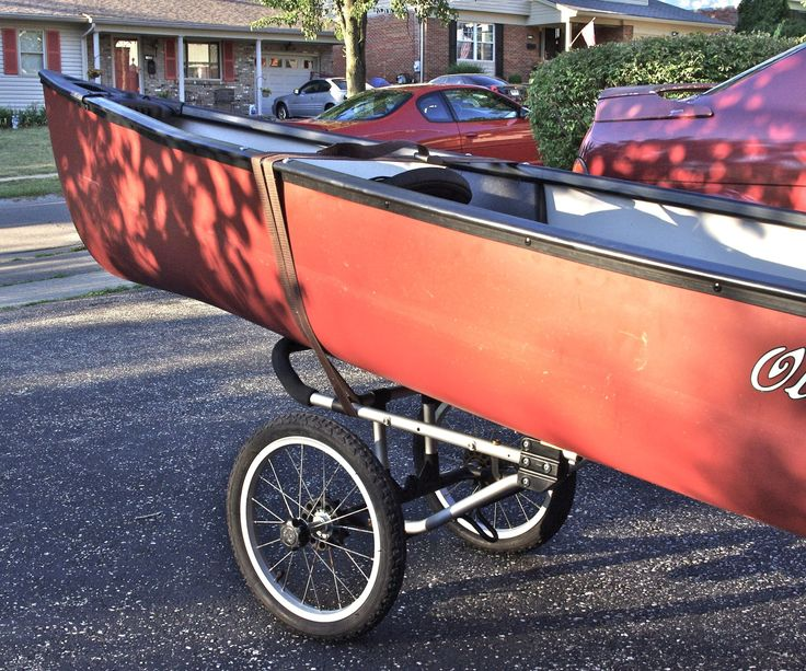 This is a canoe or kayak carrier modified from a jogging stroller. The stroller was bought at a garage saie and only required a small bit of re-engineering to create the carrier. This particular brand was made by Dreamer Design and is called Fitness First. The wheels are detachable (great for stowing in a canoe) and the frame is made of aluminum tubing. Also of note is the parking brake for the back wheels which is used to prevent the carrier from running away while you are trying...