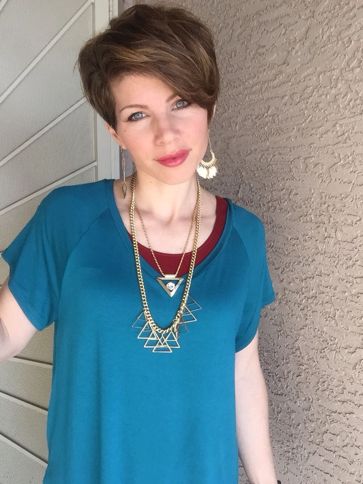 Teal and red with gold jewelry. DYT type 3 colors. pixie haircut. Romantic, high-spirited