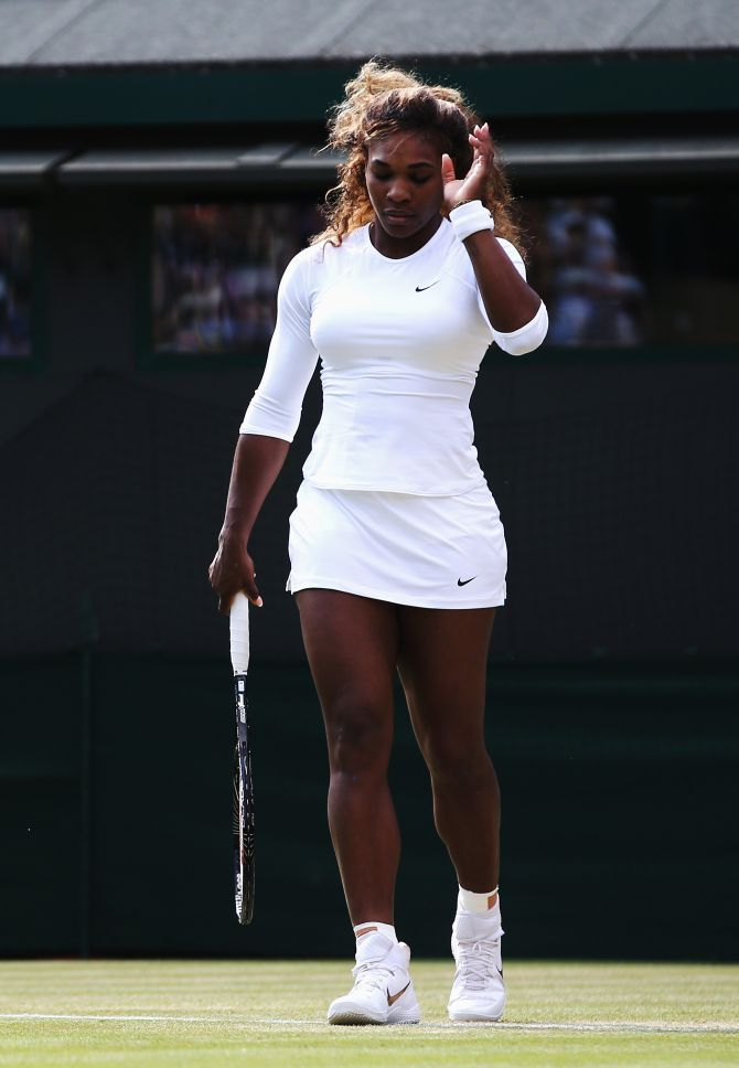 LONDON, ENGLAND - JULY 01: Serena Williams of the United States struggles during her Ladies Doubles second round match with Venus against Kristina Barrois of Germany and Stefanie Voegele of Switzerland on day eight of the Wimbledon Lawn Tennis Championships at the All England Lawn Tennis and Croquet Club on July 1, 2014 in London, England. (Photo by Jan Kruger/Getty Images)