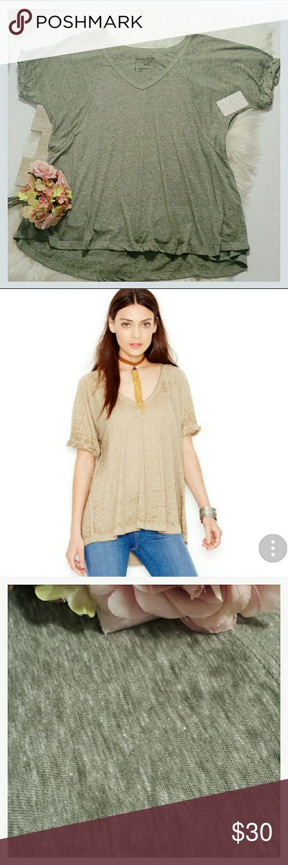 "Free People ""Fatigue"" V-neck Burnout tee Free People NWT ""Fatigue"" green spruce burnout t-shirt size medium.  Oversized, soft, and lightweight.  Sleeves are rolled and tucked. Length (front) 26"" (back) 30"". Chest: 42"". Sleeves: 12"".  (#D999) Free People Tops Tees - Short Sleeve"