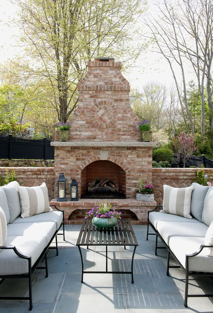 Such a beautiful patio setup! We love the couches and fireplace! With this in our backyards we would never have to leave! Perfect for home inspiration if you are looking to remodel your backyard!