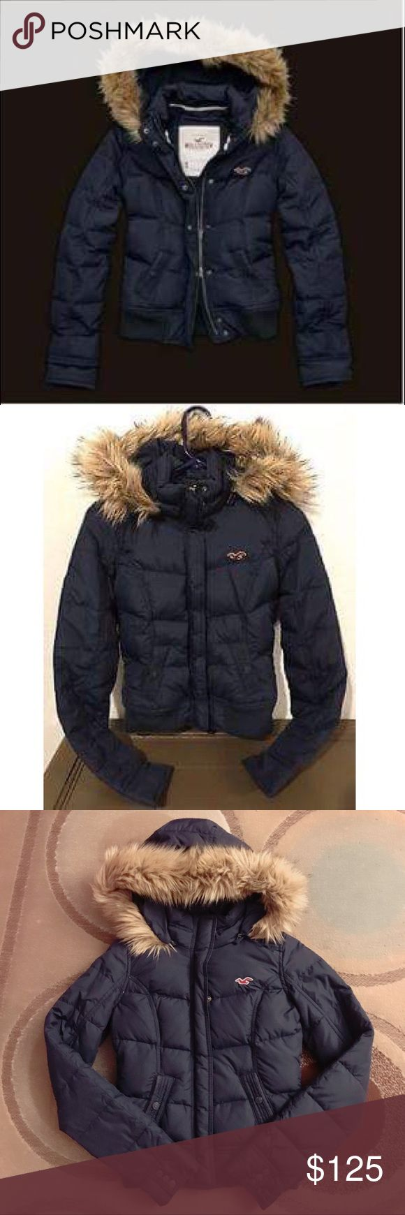 Hollister Parka Puffer Jacket Preloved. Excellent condition. No tears/rips/stains/holes or anything hidden. Hollister signature parka puffer. Navy. Size XS. Quilted. Removable faux fur hood. Comes from a smoke-free home.No trade/lowest/pp. Final sale. Hollister Jackets & Coats Puffers