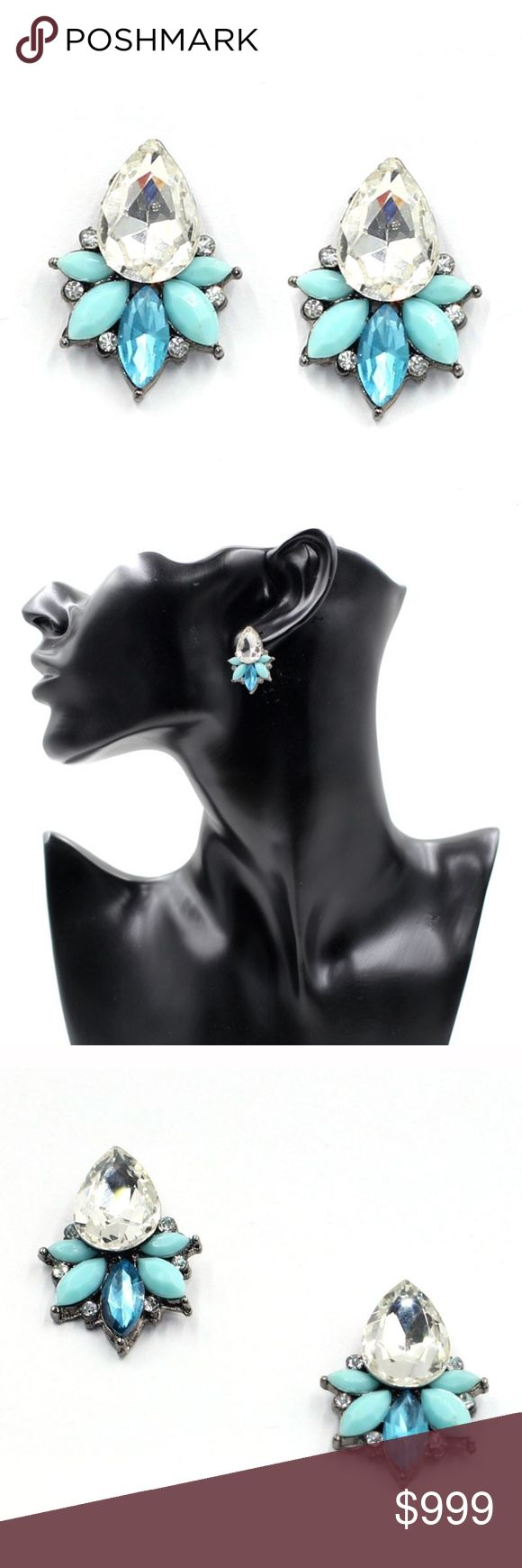 COMING SOON!! Blue & Clear Crystal Dangle Earrings Coming Soon!! (Price available upon arrival). Brand new in original packaging.  Beautiful gem drop cluster earrings feature teardrop / pear clear, aqua/turquoise, & neon sky blue crystal embellishments, these fun crystal studs are ideal for a formal or casual holiday affair! With their dainty & intricate floral design, these fabulous jewel statement earrings are both edgy & elegant. They are set in gunmetal silver zinc alloy, with…