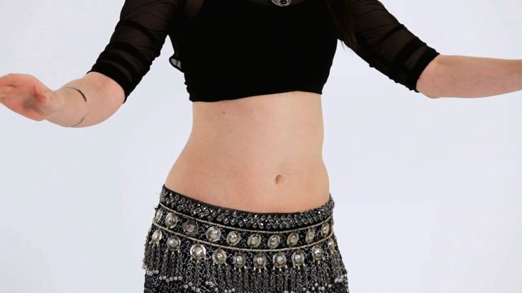 Let belly dancer Irina Akulenko teach you how to isolate your upper abs in this belly dancing video from Howcast.