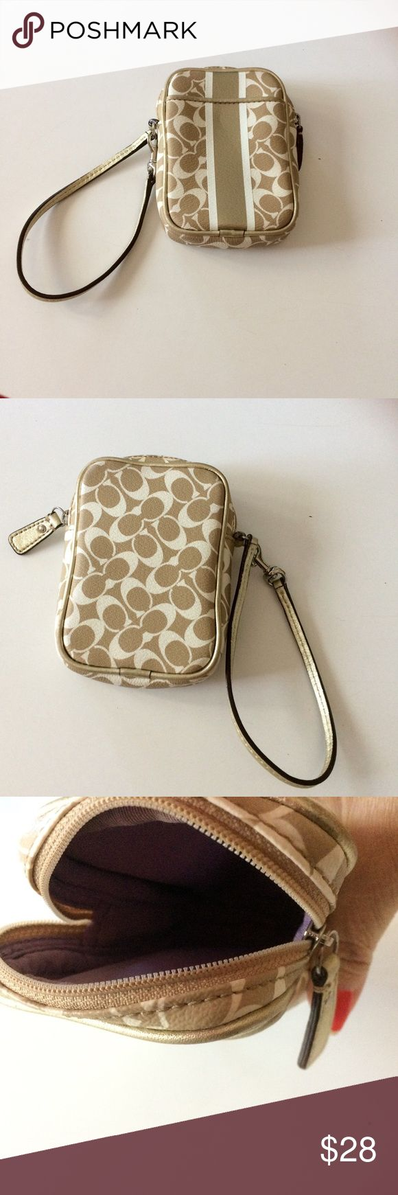 Coach Signature Gold Wristlet Cell phone holder This is a Coach wristlet cell phone holder. It would  fit a iphone 5 s. It has a faint cigarette smoke odor from former owner. Excellent condition. No rips or tears . Clean inside. It has a ykk on the zipper. Measures 5 inches tall by 3 1/2 inches wide. Coach Bags Clutches & Wristlets