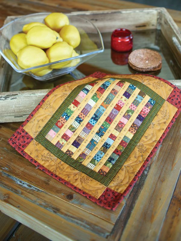 Like quilt patterns using fat quarters? We do, too! Here's one for you... this easy, sweet little quilt, Baby Coins by Annemarie S. Yohnk, uses a variety of small-scale prints. You can whip this up in an afternoon or two -- it's a great quilt to quilt in a day!