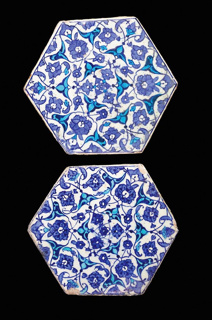 TWO IZNIK POTTERY HEXAGONAL TILES, TURKEY, CIRCA A.D. 1525 both decorated in cobalt-blue and turquoise with interfacing half-palmettes and flowerheads each 17.7cm. between parallel sides