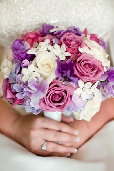 drop the pink but I love this #purple and #white floral arrangements for the bridesmamids it'd provide a nice contrast to their #purple bridesmaids dresses :)
