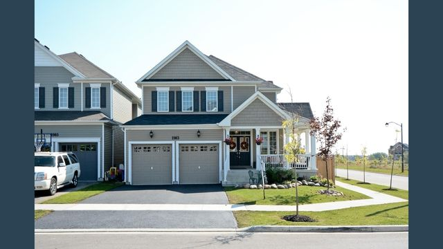 """Fully upgraded with ravine views, oversized lot & hot tub in family friendly Oshawa! Built in '14 this Tribute """"Ridgewood"""" model is full of luxury finishes. Wrap around porch with pot lights. Fabulous open concept design with hardwood floors & crown moulding throughout. Eat-in kitchen with quartz centre island & walk-out to deck. Great room with gas fireplace. 4 Spacious bedrooms, include master with his/hers walk-in closets & 5pc spa like ensuite.... And the list goes on!"""