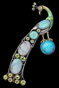 A Highly Important Guild of Handicraft Brooch In the form of a Peacock Standing on an opal orb, it's tail recumbent von Charles Robert Ashbee