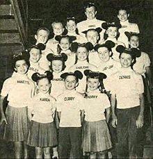 1957 Mickey Mouse Club cast photo. From left: Annette Funicello, Karen Pendleton, Cubby O'Brien. Row two: Charley Laney, Sharon Baird, Darlene Gillespie, Jay Jay Solari. Row three: Tommy Cole, Cheryl Holdridge, Larry Larsen, Doreen Tracey, Eileen Diamond. Back row: Lonnie Burr, Margene Storey, Jimmie Dodd, Bobby Burgess.