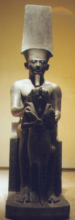 "The Egyptian Statue of Amon, ""The Hidden One,"" though theoretically invisible, this Theban God was portrayed in human form. Luxor Museum in Egypt"