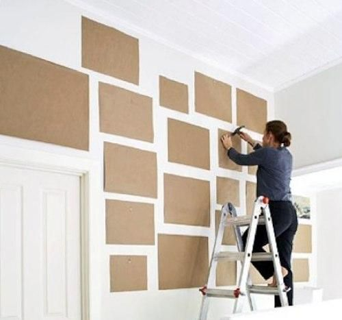 use cardboard to arrange a gallery wall before nailing things up