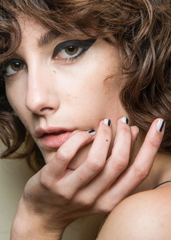 Browse the best nail art ideas from fashion month Spring 2017 at @StyleCaster | Vivetta's white nails with black center stripes