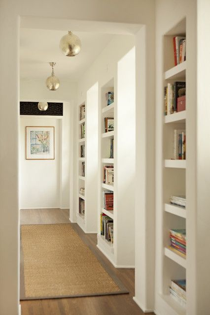 Built-in bookshelves, why waste all that space between studs! just make the walls deeper (2x6 instead of 2x4) and add shelves along hallway