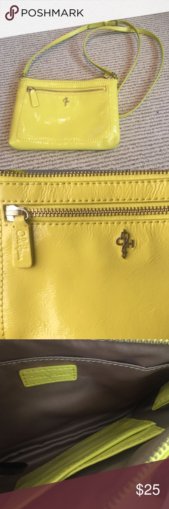 COLE HAAN patent crossbody New without tags yellow patent COLE HAAN crossbody purse. Bought from a sample sale and never used it. Outside zipper pocket. Inside flap pocket and card pocket. Adjustable strap. Cole Haan Bags Crossbody Bags