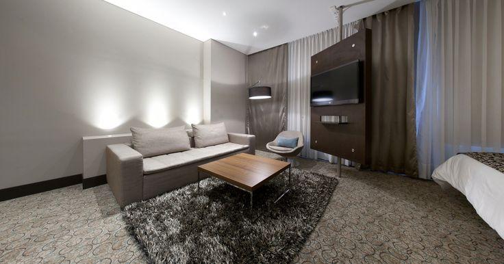 BoConcept Mezzo sofa, Veneto chair, Lugo coffee table and Shower mega lamp at Hotel Cosmos Insignia, Colombia