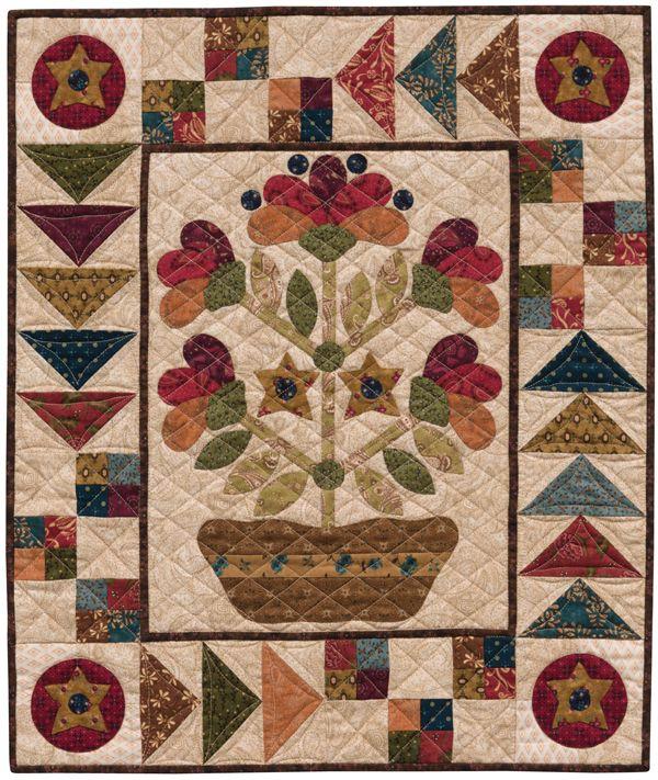 Folk Art Dish Garden wall quilt pattern by Kim Diehl.  Free with Kim's applique freezer paper.