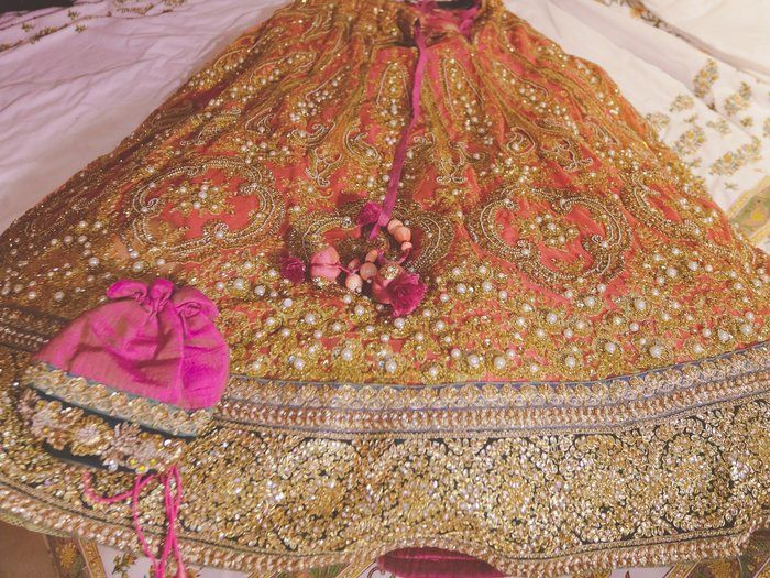 Peach and green embellished pearl work lehenga