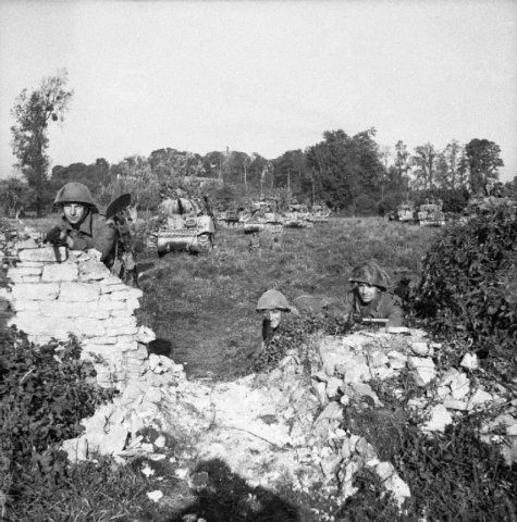 Caen, Infantry and tanks waiting to move forward at the start of Operation…