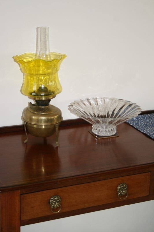 A lovely Victorian Oil Lamp, with its stunning Citrine coloured glass bowl, and glass chimney, and Brass base with stand  Glass bowl measures 7.5 inches in diameter, and it stands 18 inches to top of chimney.